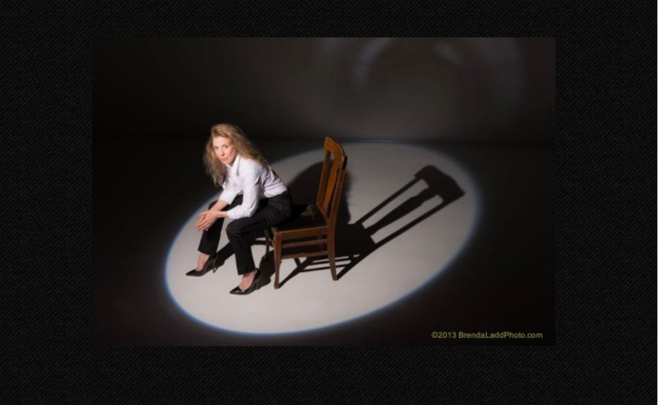seated Suzi Pensive