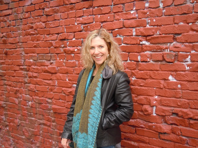 suzi red brick wall